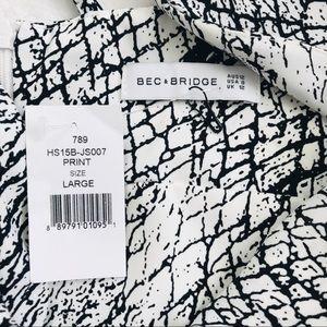 Bec & Bridge Pants - Revolve Bec & Bridge printed low plunge romper